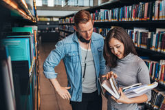 Students choosing a book in a library Royalty Free Stock Photography