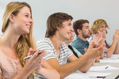 Students clapping hands in classroom Stock Image