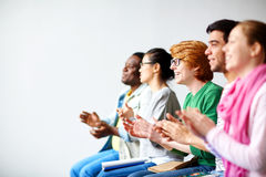 Students clapping hands Royalty Free Stock Image