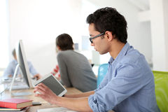 Students in class using tablet Royalty Free Stock Photos