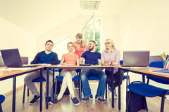Students in classroom during the break Stock Photos