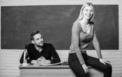 Students in classroom chalkboard background. Equal rights and liberties. Man and woman study university. Right education stock photo