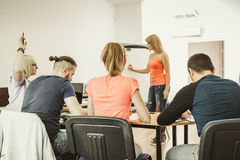 Students in classroom learning english Stock Image
