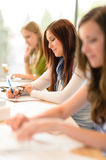 Students in classroom sitting in a row Stock Photography
