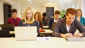 Students in classroom using computer Stock Images