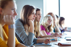 Students in classroom - young pretty female college student Royalty Free Stock Images