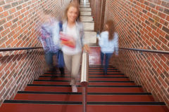 Students climbing stairs. In school Royalty Free Stock Photography
