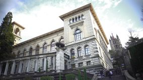 Students climbing the stairs of University Library, Palais de Rumine in Lausanne. Stock footage stock video footage