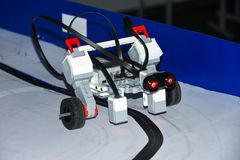 Robot car assembled from designer details rides on magnetic road by startup students stock photography