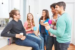 Students in the coffee break at Smalltalk. Students in the coffee break at the relaxed small talk in the coworking office royalty free stock photo