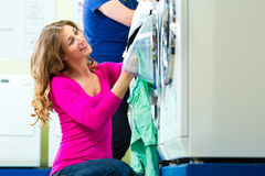 Students in a coin laundry washing Stock Images