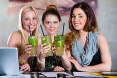 Students or colleagues in cafe after closing time Royalty Free Stock Photo