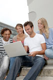 Students in college with computer Royalty Free Stock Image