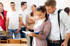 Students college couple Royalty Free Stock Photos