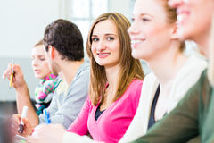 Students in college learning Royalty Free Stock Photos