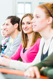 Students in college learning Stock Photo