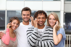 Students in college with telephone Royalty Free Stock Images
