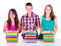 Students with colorful books Royalty Free Stock Photo
