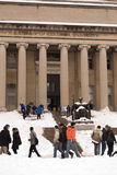 Students at Columbia University in the snow. Students in front of the main library of Columbia University after the snow storm Stock Photos
