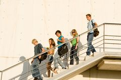 Students coming out of school royalty free stock image