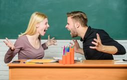 Students communicate classroom chalkboard background. Violence and bullying. Communication between group mates. Friendship and relations. Compromise solution stock images