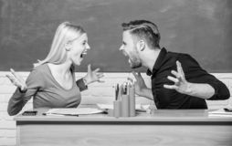 Students communicate classroom chalkboard background. Violence and bullying. Communication between group mates. Friendship and relations. Compromise solution stock photo