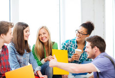 Students communicating and laughing at school. Education concept - students communicating and laughing at school royalty free stock photo