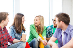 Students communicating and laughing at school. Education concept - students communicating and laughing at school royalty free stock photography