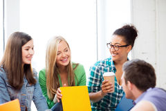 Students communicating and laughing at school Stock Photo