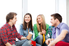 Students communicating and laughing at school. Education concept - students communicating and laughing at school royalty free stock photos