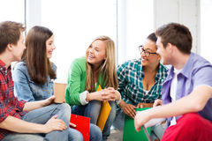 Students communicating and laughing at school Stock Image