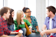 Students communicating and laughing at school Royalty Free Stock Image