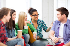Students communicating and laughing at school Royalty Free Stock Photos