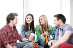 Students communicating and laughing at school Royalty Free Stock Images