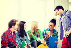 Students communicating and laughing at school Stock Images