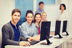 Students with computer monitor at school Royalty Free Stock Photo