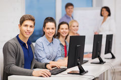 Students with computer monitor at school Stock Image