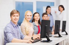 Students with computer monitor at school Stock Photo