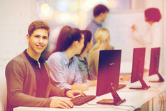 Students with computer monitor at school Stock Images