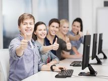 Students with computer monitor showing thumbs up Royalty Free Stock Image