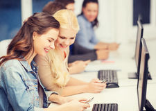Students with computer monitor and smartphones Stock Photos