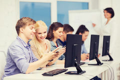 Students with computer monitor and smartphones Stock Photo