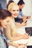 Students with computer monitor and smartphones Stock Images
