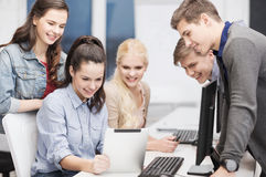 Students with computer monitor and tablet pc Royalty Free Stock Images