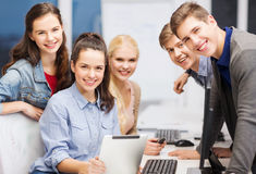 Students with computer monitor and tablet pc Stock Photo