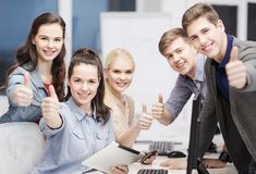 Students with computer monitor and tablet pc. Education, techology and internet concept - group of smiling students with computer monitor and tablet pc Stock Image