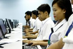 Students of a computer school. Computer school students in front of computers royalty free stock images