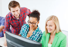 Students with computer studying at school Stock Image
