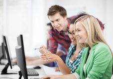 Students with computer studying at school. Education concept - students with computer studying at school Royalty Free Stock Photos