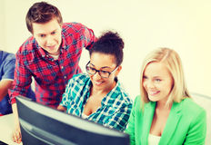 Students with computer studying at school. Education concept - students with computer studying at school Royalty Free Stock Images